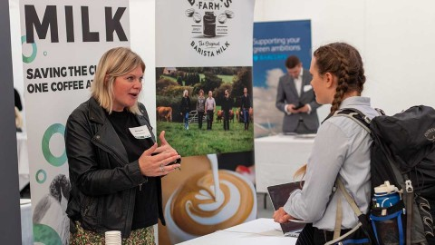 """A local food producer and conference attendee engaging in discussion at the recent """"Eco-I 2019 Conference"""" hosted by CGE at Lancaster University."""